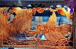 Gallo di combattimento nella scultura di cuoio della mucca Fotografia Stock