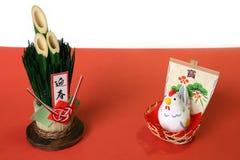 Gallo japonés y bambú del Año Nuevo aislados Fotografía de archivo