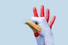 Gallo a mano Fotografía de archivo