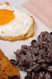 Gallo pinto breakfast. Hearty central american breakfast, gallo pinto with ham and egg royalty free stock image