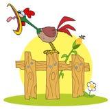 Gallo ruidoso en una cerca de madera por un tallo del maíz Imagenes de archivo