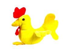 Gallo suave del amarillo del juguete con el pico rojo - símbolo del Año Nuevo Foto de archivo