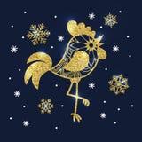 Gallo y copos de nieve de oro del brillo en fondo azul marino S Foto de archivo