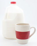 Gallon of milk and a cup Stock Image