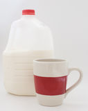 Gallon of milk and a cup Royalty Free Stock Photo