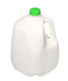 Gallonen-Milchflasche mit grüner Kappe auf Weiß Stockfotos