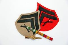 Galloni e medaglie di Marine Corps Immagine Stock