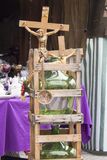 Gallons seen on flea market. Italian flea market presents gallons and crucifix royalty free stock photos