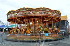 Gallopers Carousel Family Ride. Carousels are commonly populated with horses, for example pigs, zebras, tigers or mythological creatures such as dragons or Royalty Free Stock Image