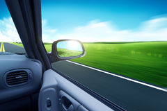 Galloping car and rearview mirror Royalty Free Stock Images