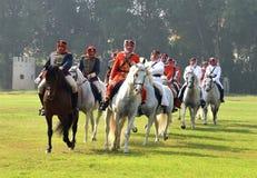 Galloping horsemen Stock Photos