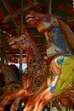 Galloping horses carousel. Stock Image