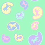 Galloping ponies on paisley pattern Royalty Free Stock Photos