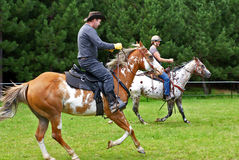 Galloping Riders Royalty Free Stock Image