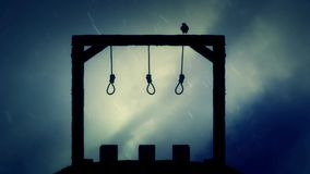 The Gallows Ready for an Execution with a Black Raven in the Rain stock footage