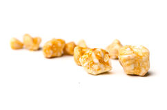 Gallstones. Yellow gall stones from a persons gall bladder over white background royalty free stock images