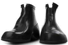 Galoshes. Black rubber galoshes on white Royalty Free Stock Image