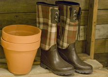 Galoshes and flower pot in Gardener's Shed Stock Images