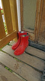 Galoshes on the porch Stock Image