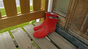 Galoshes on the porch Royalty Free Stock Photos