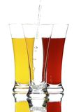 Galsses with juice. Glasses with juice on the white background Stock Photos