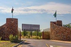 Galton Gate to Etosha National Park in Namibia and the entrance sign. Etosha, Namibia - April 2, 2019 : The Galton Gate to Etosha National Park in Namibia and stock photo