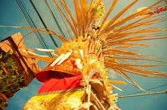 Galungan Kuningan celebration on Bali. Galungan Kuningan feast on Bali- decorated pole called  penjor Stock Photography