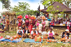 Galungan and Kuningan Ceremony, Balli, Indonesia. Balinese priest and people in traditional dress during Galungan and Kuningan Ceremony at Agung Besakih complex Royalty Free Stock Image