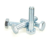 Galvanised bolts. On a white background royalty free stock images