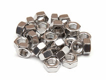 Galvanised hexagon nuts. Closeup of galvanised hexagon nuts on a white background stock image