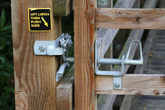 Galvanised latch system. Galvanised modern spring loaded latch system on country gate to prevent animal escape royalty free stock photos