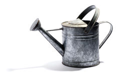 Galvanised metal watering can. With a double handle and spout for watering plants in the garden on white with shadow, side view royalty free stock photo