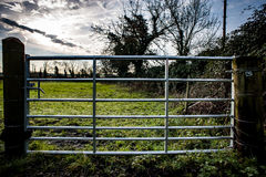 Galvanised seven bar gate. New, galvanised steel farm gate with seven bars stock photos