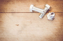 Galvanized bolts on a wood background Stock Photo