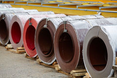 Galvanized coils and Prepainted Galvanized coils lying Stock Photo