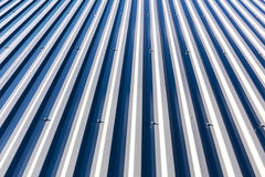 Galvanized metal steel roof under direct sunlight Royalty Free Stock Images