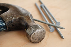 Galvanized Nails and a Claw Hammer Stock Image