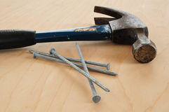 Galvanized Nails and a Claw Hammer Royalty Free Stock Image