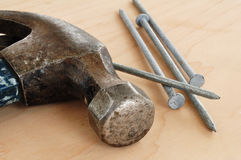 Galvanized Nails and a Claw Hammer Royalty Free Stock Photos