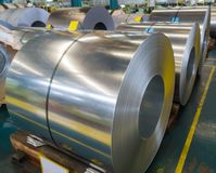 Galvanized rolled steel sheet in coil in manufacturing, Raw material for many industries stock photo