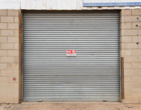 Galvanized  Roller Door with NO PARKING Sign Royalty Free Stock Photo