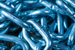 Galvanized steel chain. Background of galvanized steel chain links, in blue tone. Shallow DOF Stock Photos