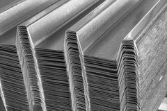 Galvanized steel corrugated roof profile. Stacked on a palette stock photography