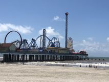 Galveston's pleasure pier. A perspective angle of Galveston's famous pleasure Royalty Free Stock Image