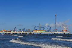 Galveston Island Pleasure Pier. The Pleasure Pier rides reaching out over the water on Galveston, Texas, USA Royalty Free Stock Images