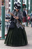 Galveston, TX/USA - 12 06 2014: Lady dressed in Victorian style texting on the phone at Dickens on the Strand Festival in Galvesto Stock Photography