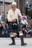 Galveston, TX/USA - 12 06 2014: Male musician in traditional Scottish costume plays drum at Dickens on the Strand Festival in Galv Royalty Free Stock Image
