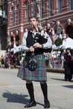 Galveston, TX/USA - 12 06 2014: Male musician in traditional Scottish costume plays harp at Dickens on the Strand Festival in Galv Royalty Free Stock Images