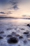 Galway Bay. Water washing over rocks in foreground Stock Photos