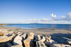 Galway Bay. In Ireland. The Burren can be seen in the distance Royalty Free Stock Photo